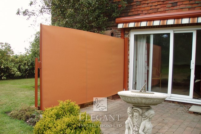 Elegant Awnings With Sides Have A Removable Ground Socket Post Holding The Screens Taught