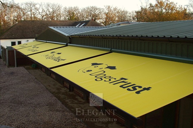 Elegant Awnings installed for the DogsTrust create shade and shelter above the kennels