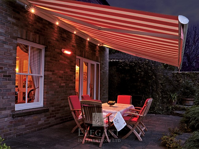 Awnings with spotlights create an inviting space after dark